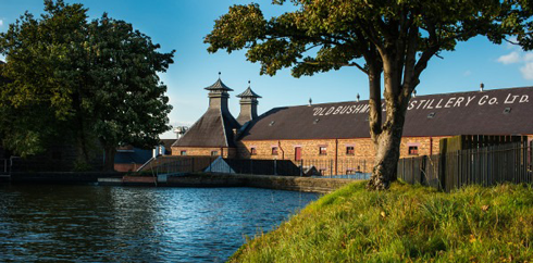 Image of 'Old Bushmills' Distillery, with River Bush tributary in foreground.
